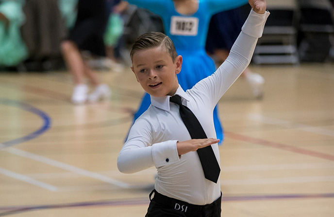 A photo of a child ballroom dancing at a competition