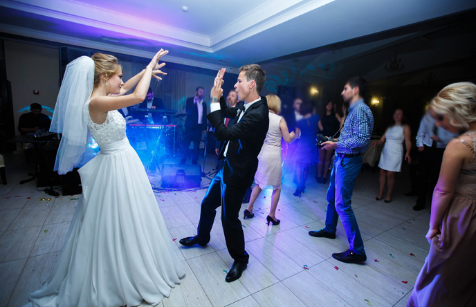 A photo of a Wedding Dance by the Bride and Groom